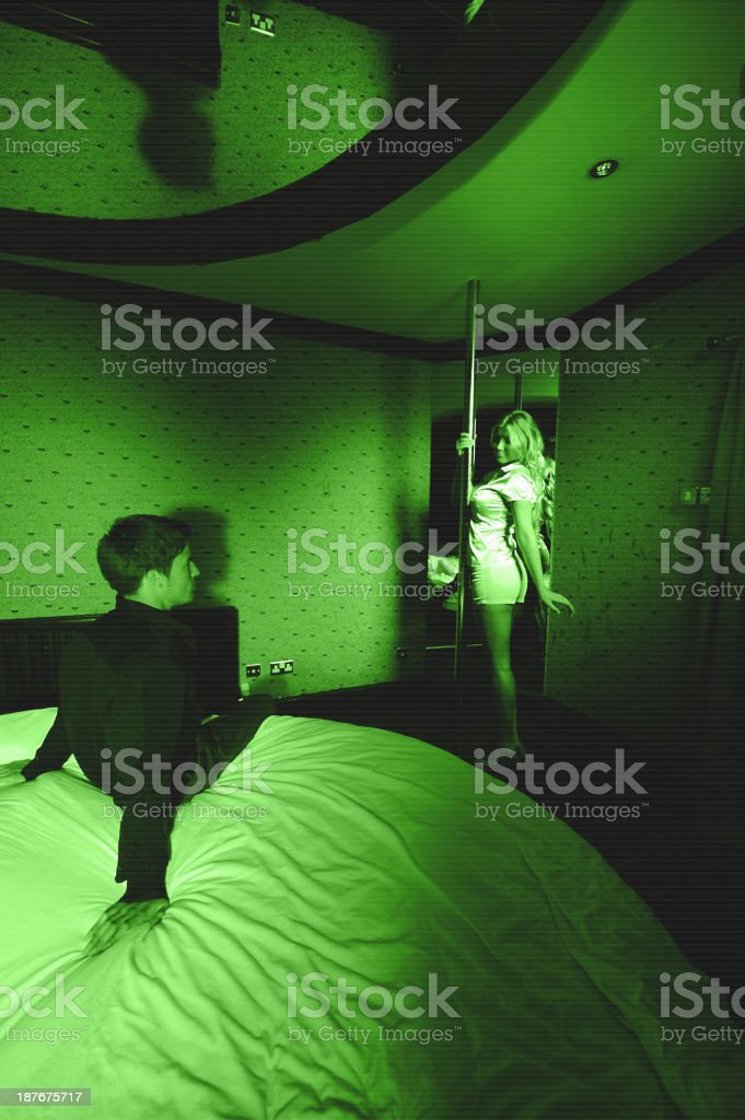 Surveillance image of young couple in bedroom stock photo