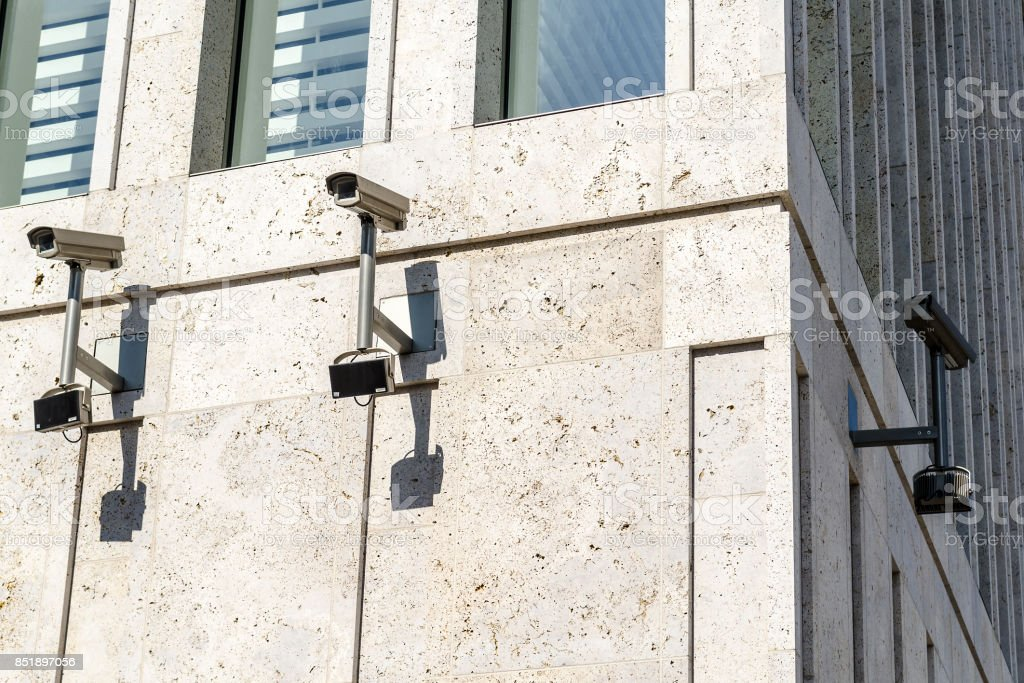 surveillance monitoring security camera on a house corner stock photo