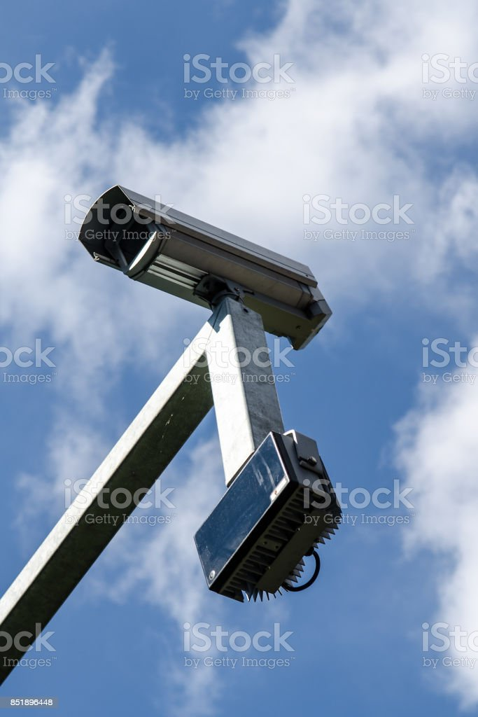 surveillance monitoring security camera with blue sky stock photo