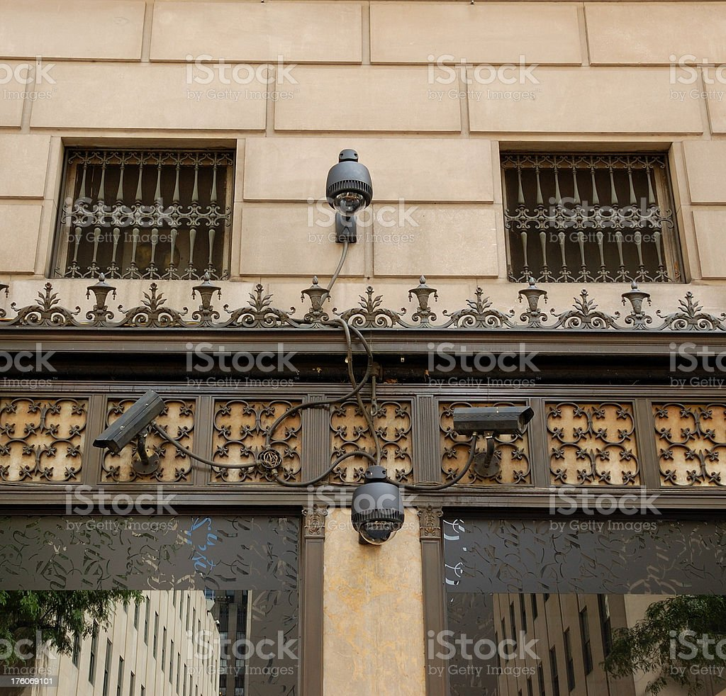 Surveillance security cameras on NYC  retail store building royalty-free stock photo