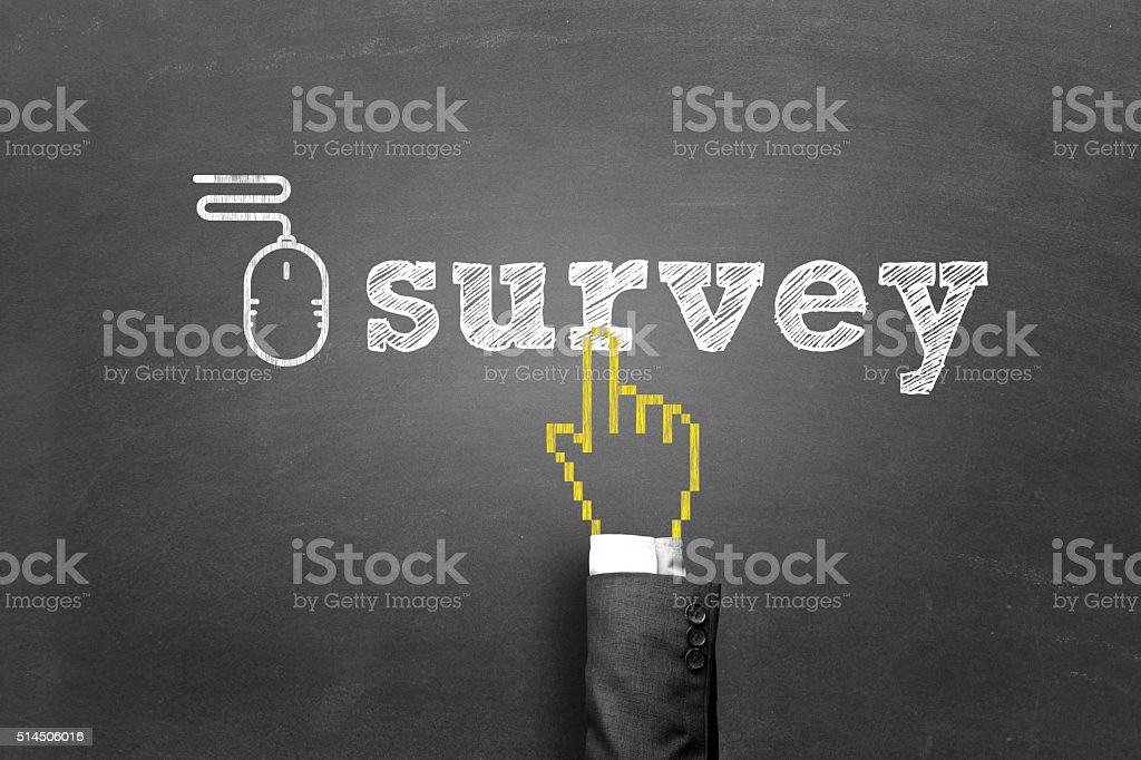 Survey and mouse sign on blackboard stock photo