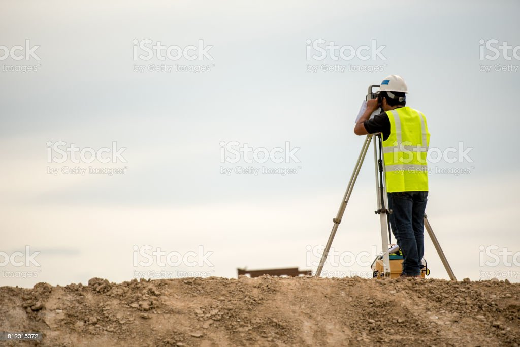 survey engineer in construction site use theodolite mark a concrete...