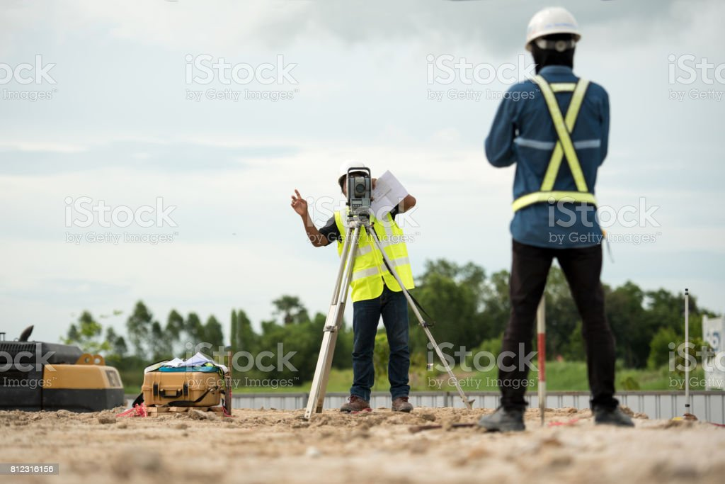 survey engineer in construction site use theodolite mark a concrete pile co ordinate stock photo