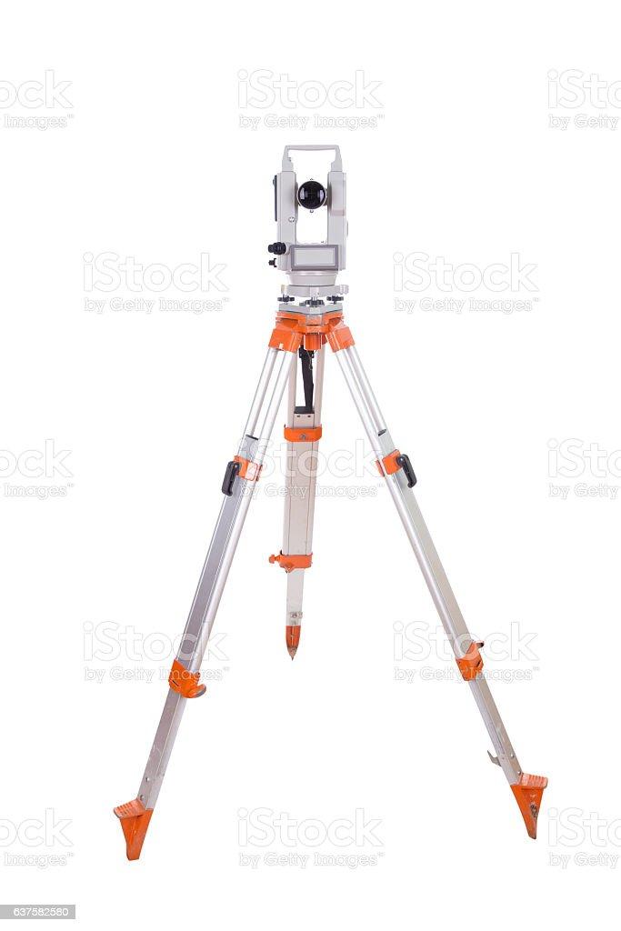 Survey equipment theodolite on a tripod. Isolated on white stock photo
