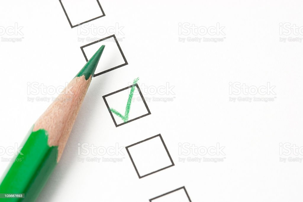 A survey with one of the boxes checked with a green pencil royalty-free stock photo