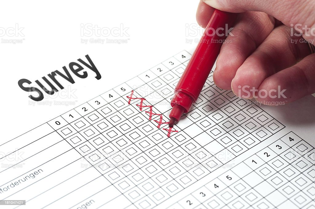 survey with red pen and hand stock photo