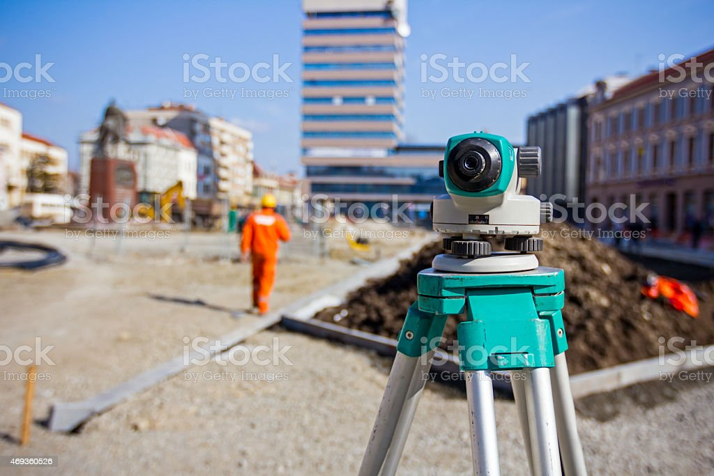 Surveying equipment to infrastructure construction project stock photo