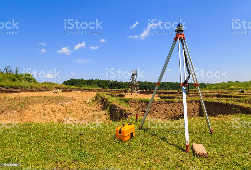 Surveying measuring equipment on tripod stock photo