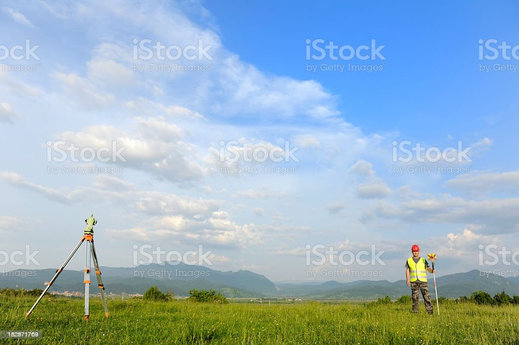 Surveying with total station stock photo