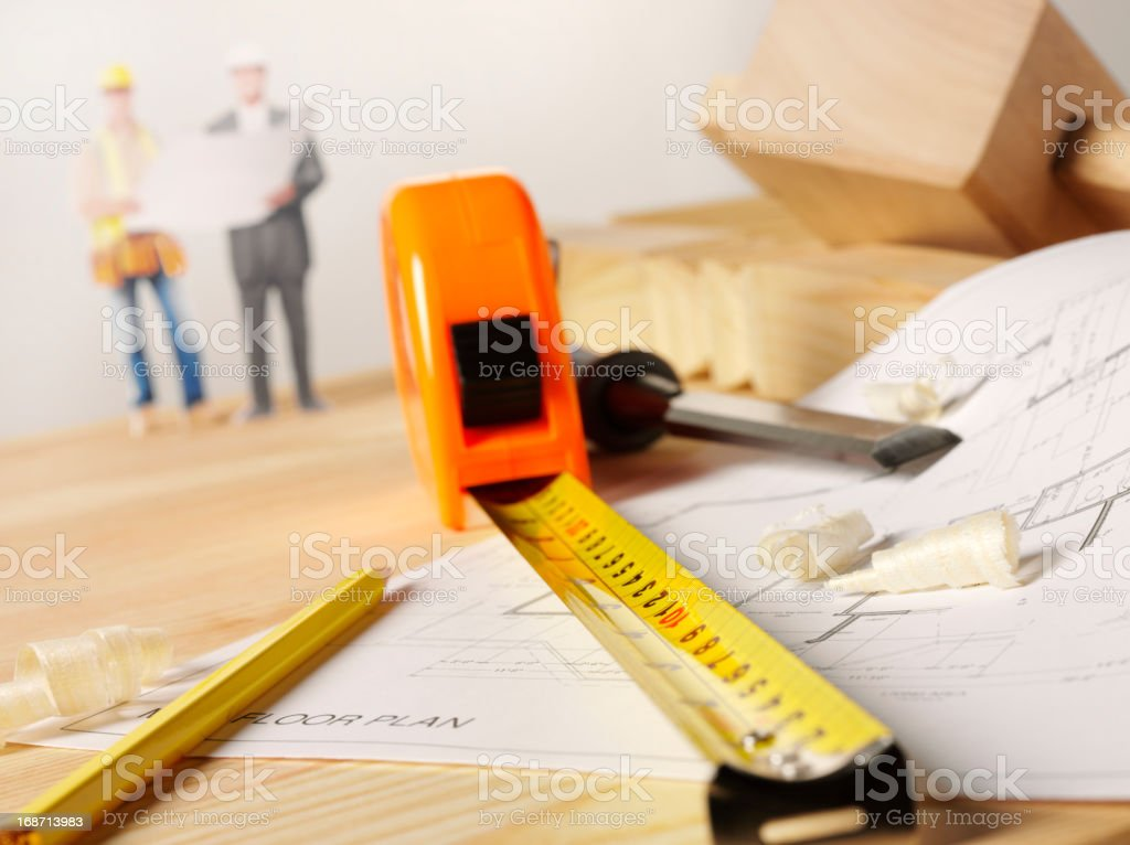 Surveyor and Blueprint royalty-free stock photo