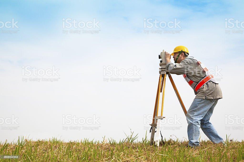Surveyor engineer making measure on the field stock photo