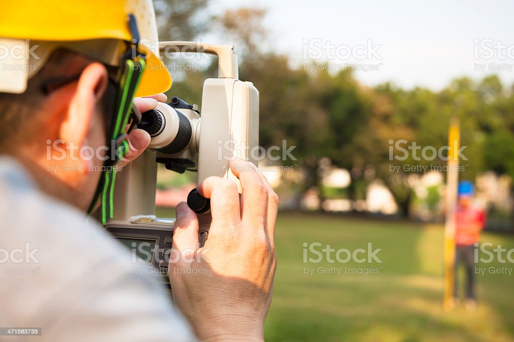 Surveyor engineer with partner making measure stock photo