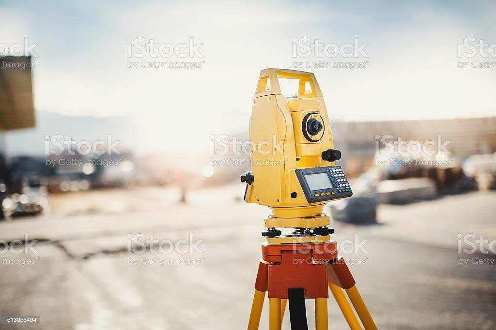 Surveyor equipment at construction site stock photo