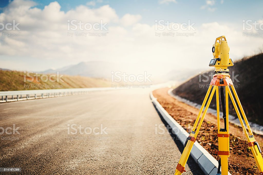 Surveyor equipment at construction site stock photo