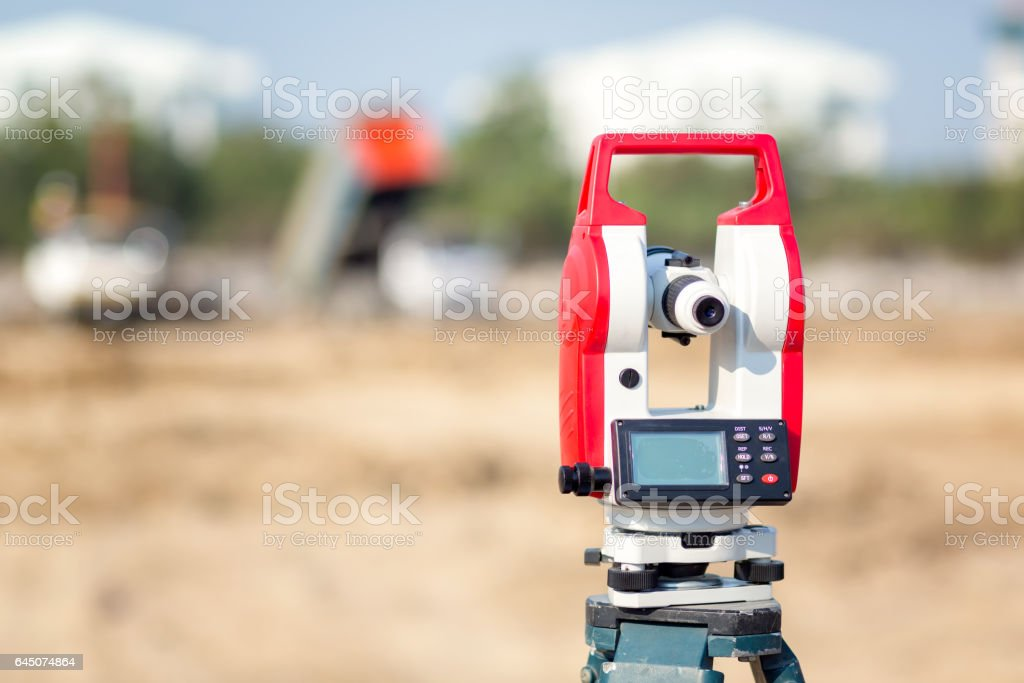 Surveyor equipment tacheometer or theodolite outdoors at construction site for civil engineer checking the construction area stock photo
