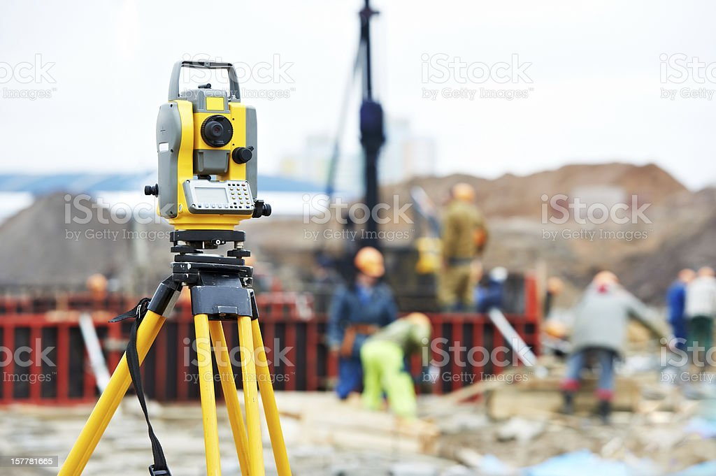 surveyor equipment theodolite at construction site stock photo