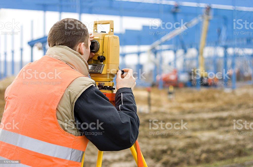 Surveyor on construction site royalty-free stock photo