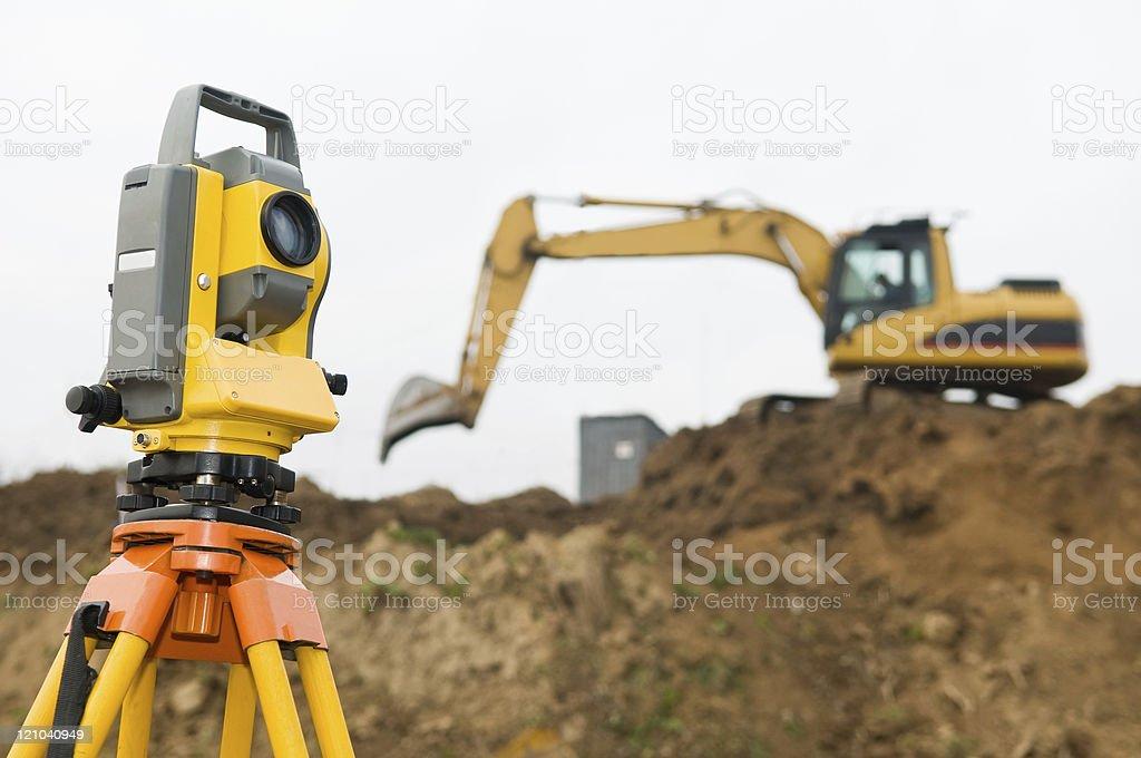 Surveyor theodolite on tripod stock photo