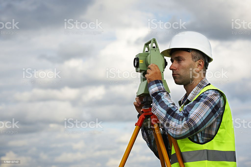 Surveyor with totalstation stock photo