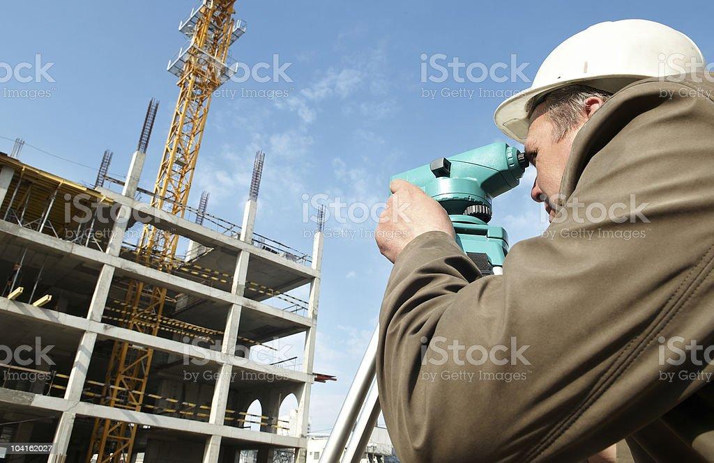 Surveyor with transit level equipment royalty-free stock photo