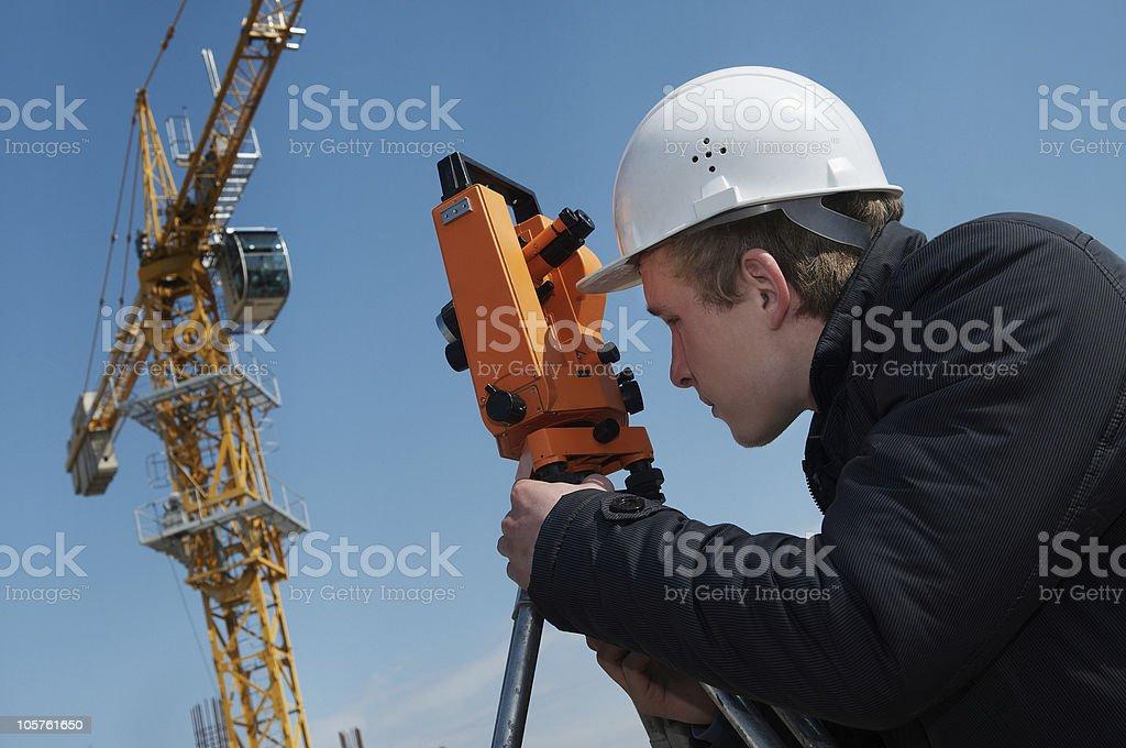 Surveyor with transit level equipment stock photo