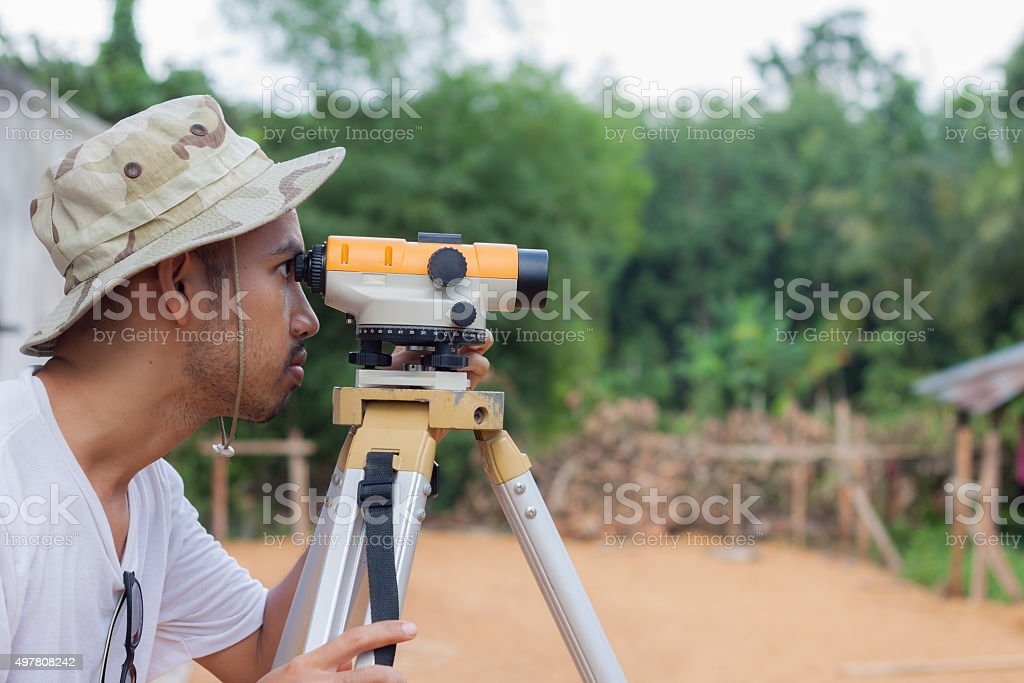 Surveyor worker working with theodolite stock photo