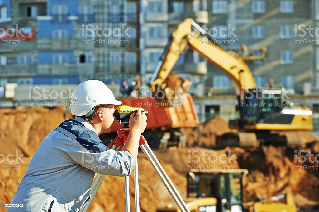 Surveyor working with theodolite equipment stock photo