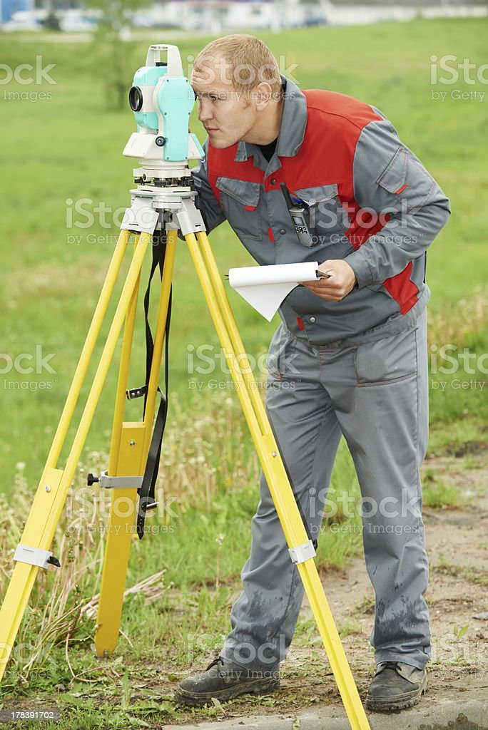 surveyor works with theodolite royalty-free stock photo