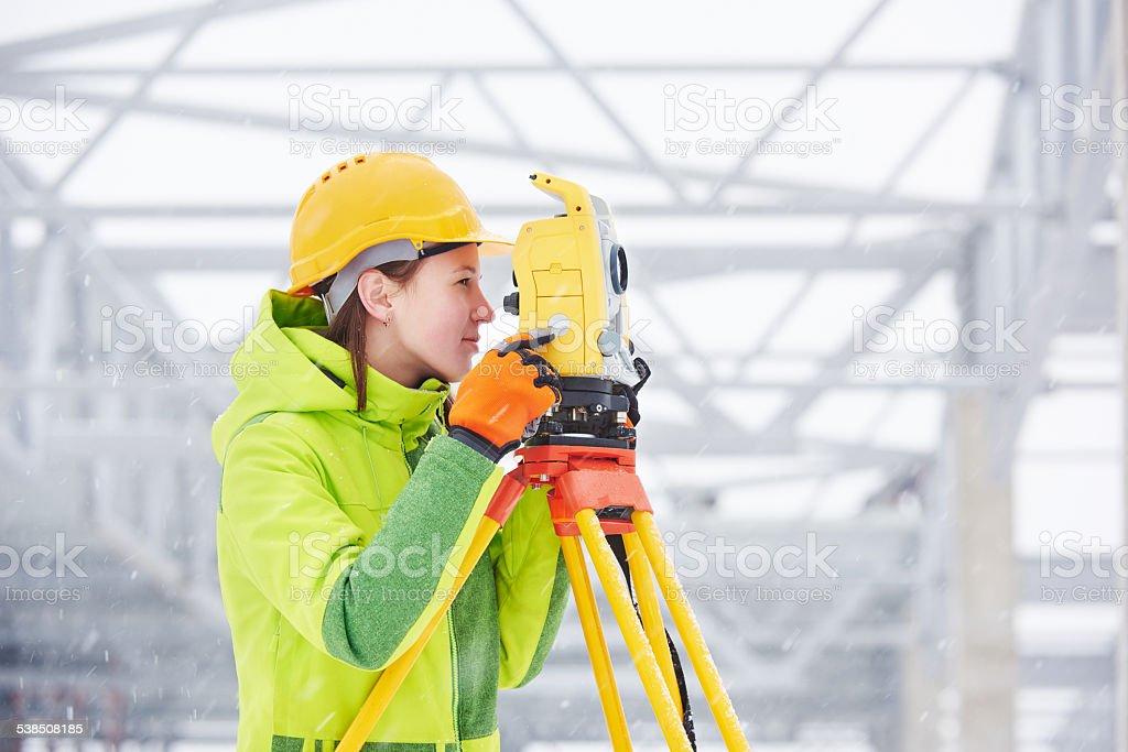 surveyor works with theodolite stock photo