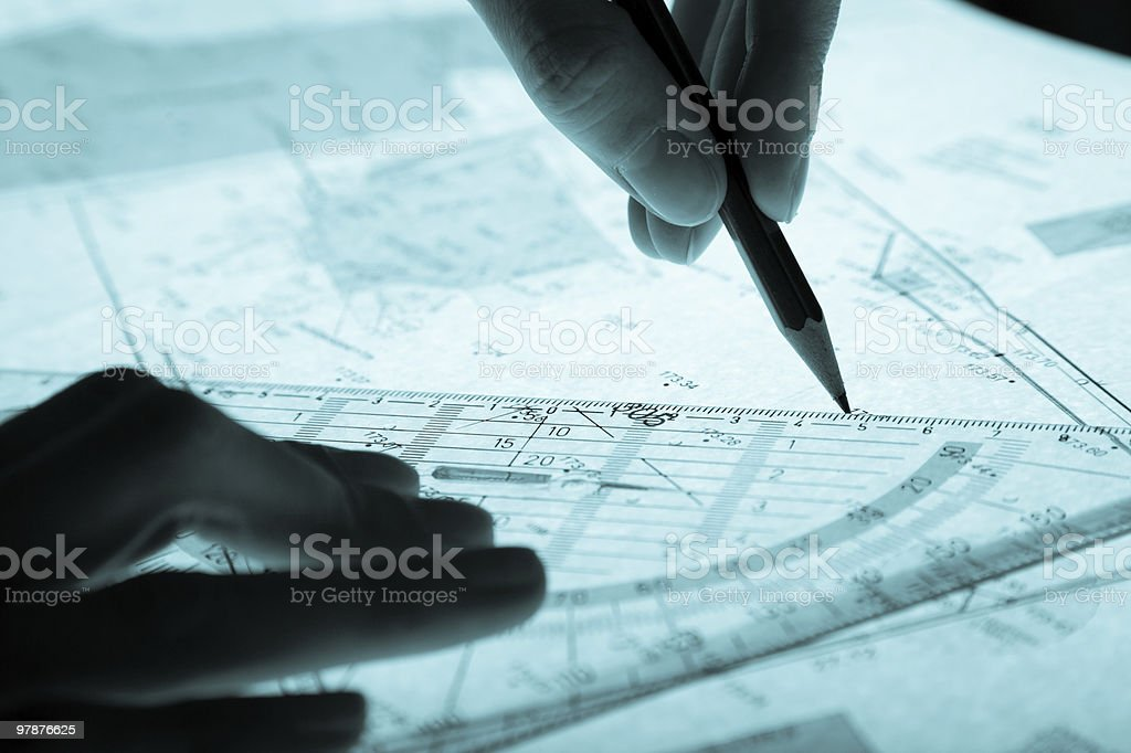 surveyor's plan and hands with a pencil royalty-free stock photo