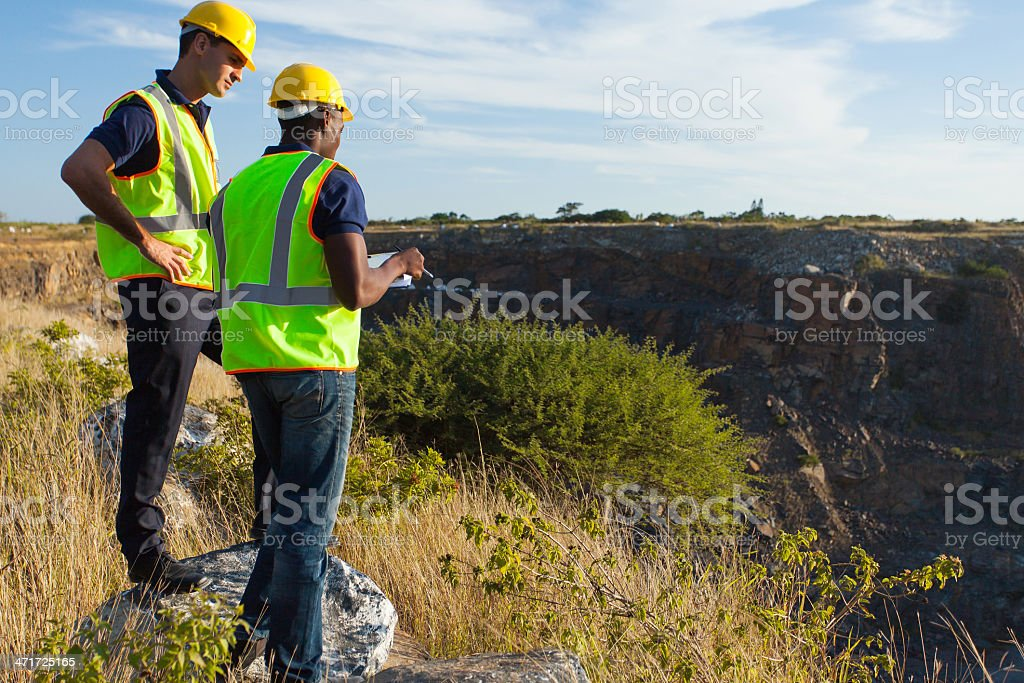 surveyors working at mining site stock photo