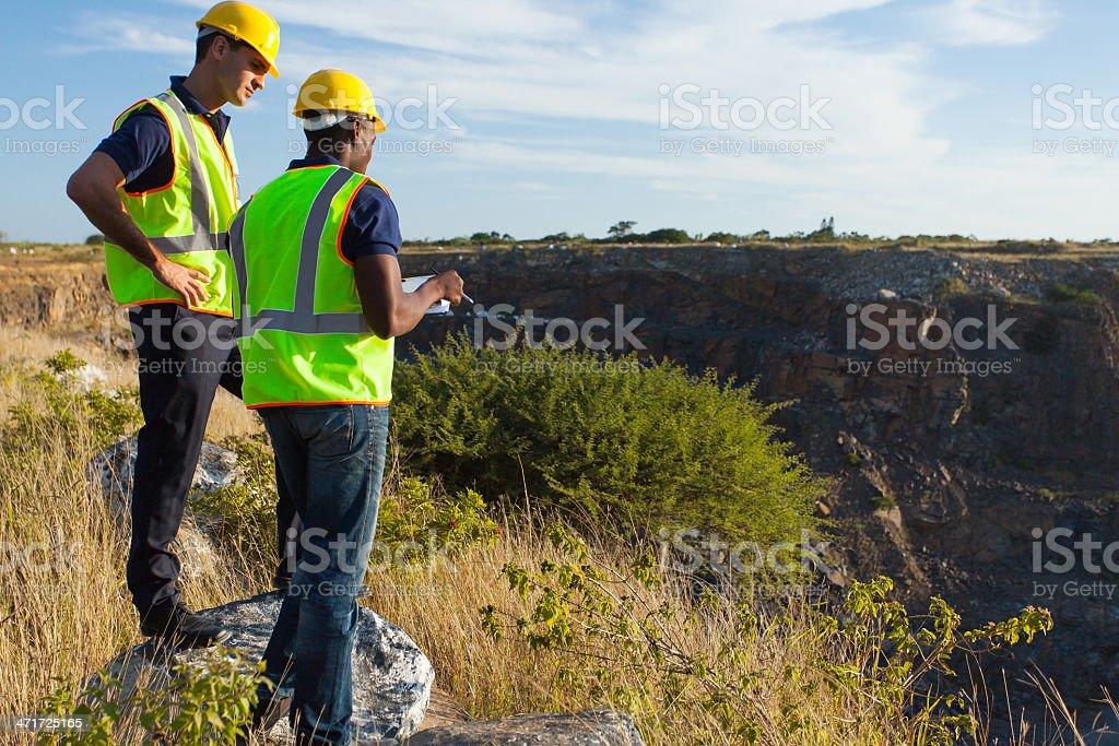 surveyors working at mining site stock photo