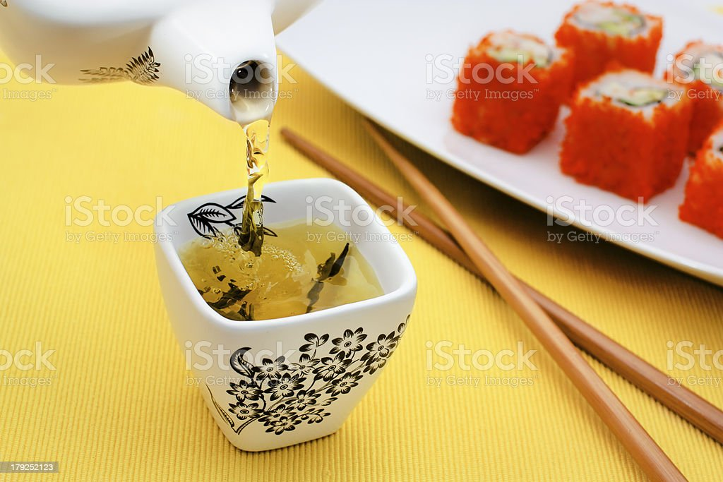 Sushi and pouring tea royalty-free stock photo