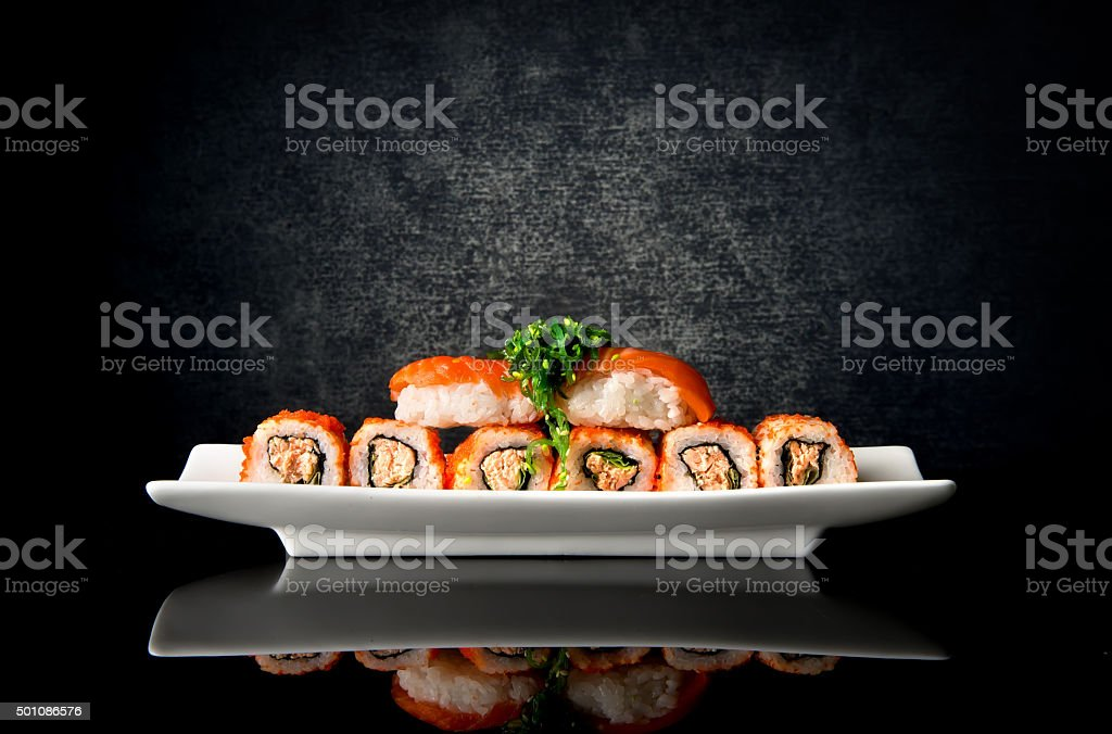 Sushi and rolls in plate stock photo