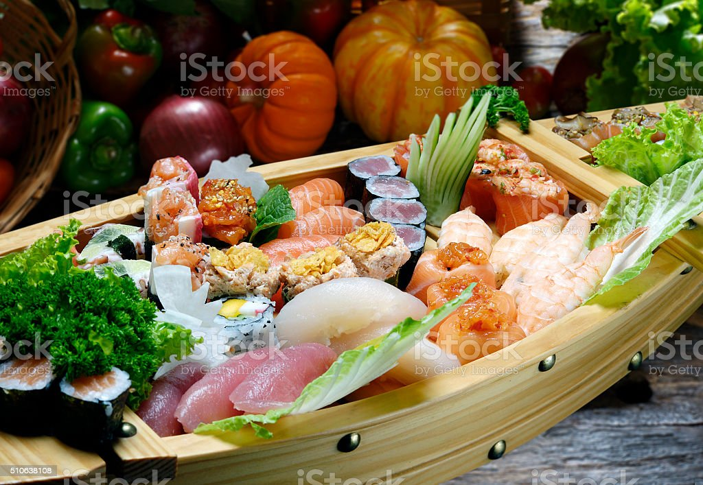 sushi and sashimi boat stock photo
