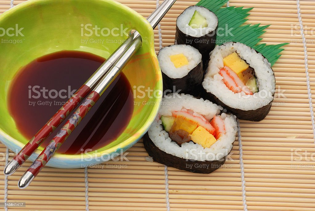 sushi and soya sauce on bamboo mat royalty-free stock photo