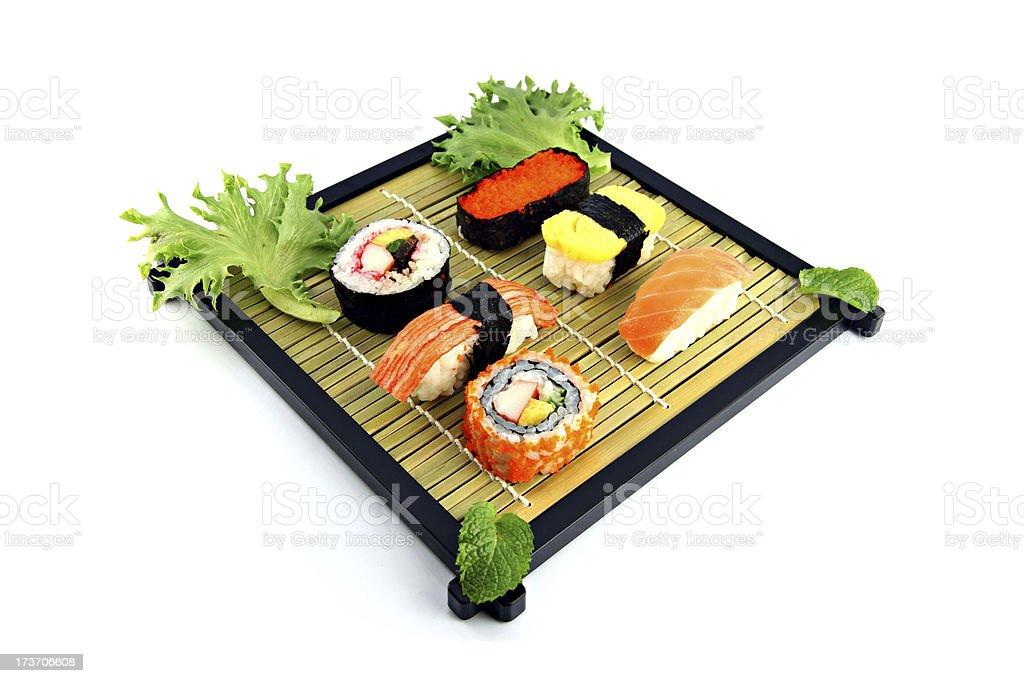 Sushi arrange them on a bamboo dish. royalty-free stock photo
