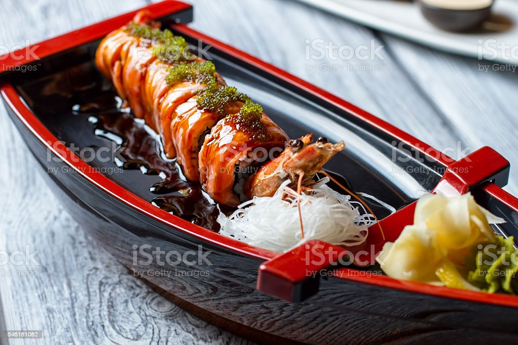 Sushi boat with a shrimp. stock photo