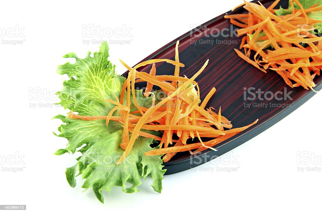 Sushi dish and vegetables on the side. royalty-free stock photo