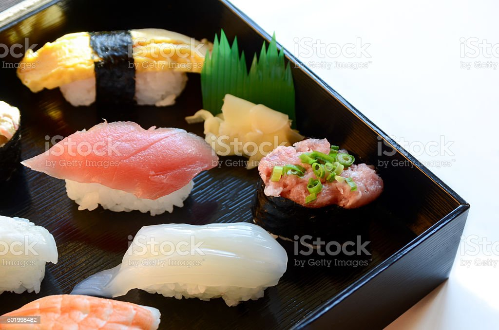 sushi in a box on white background stock photo