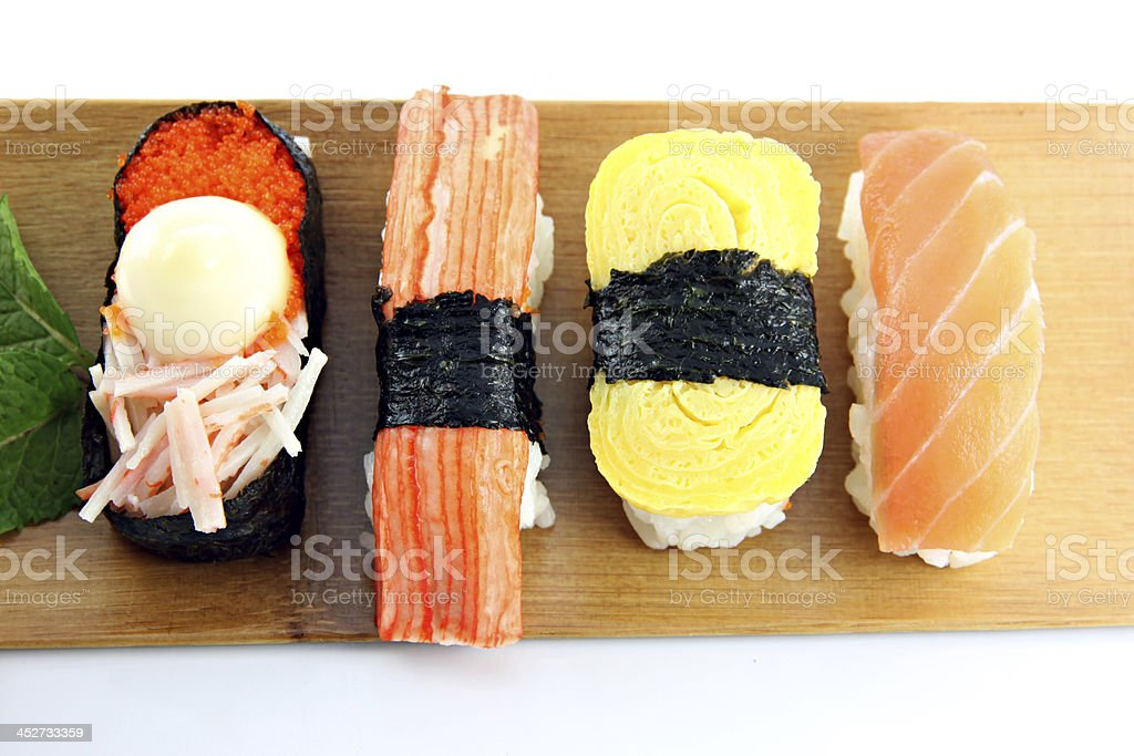 Sushi in bamboo dish on the white background. royalty-free stock photo