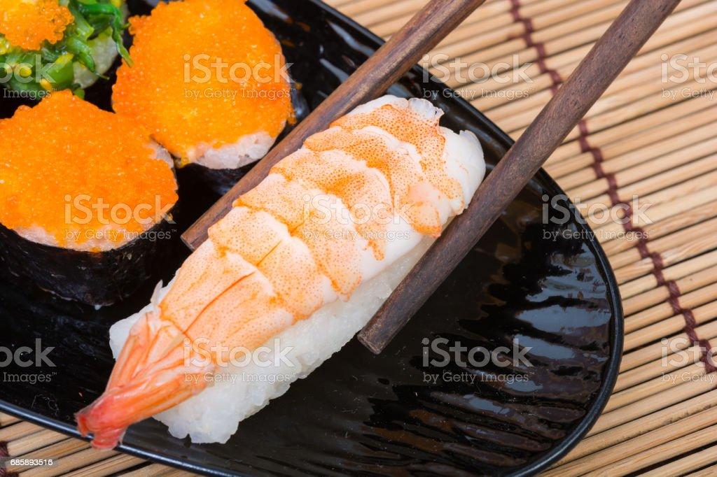 sushi in black dish stock photo
