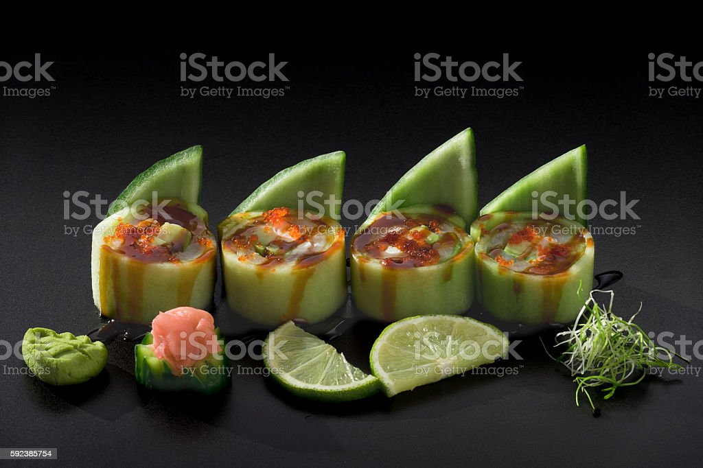 Sushi in cucumbers with avocado and caviar stock photo