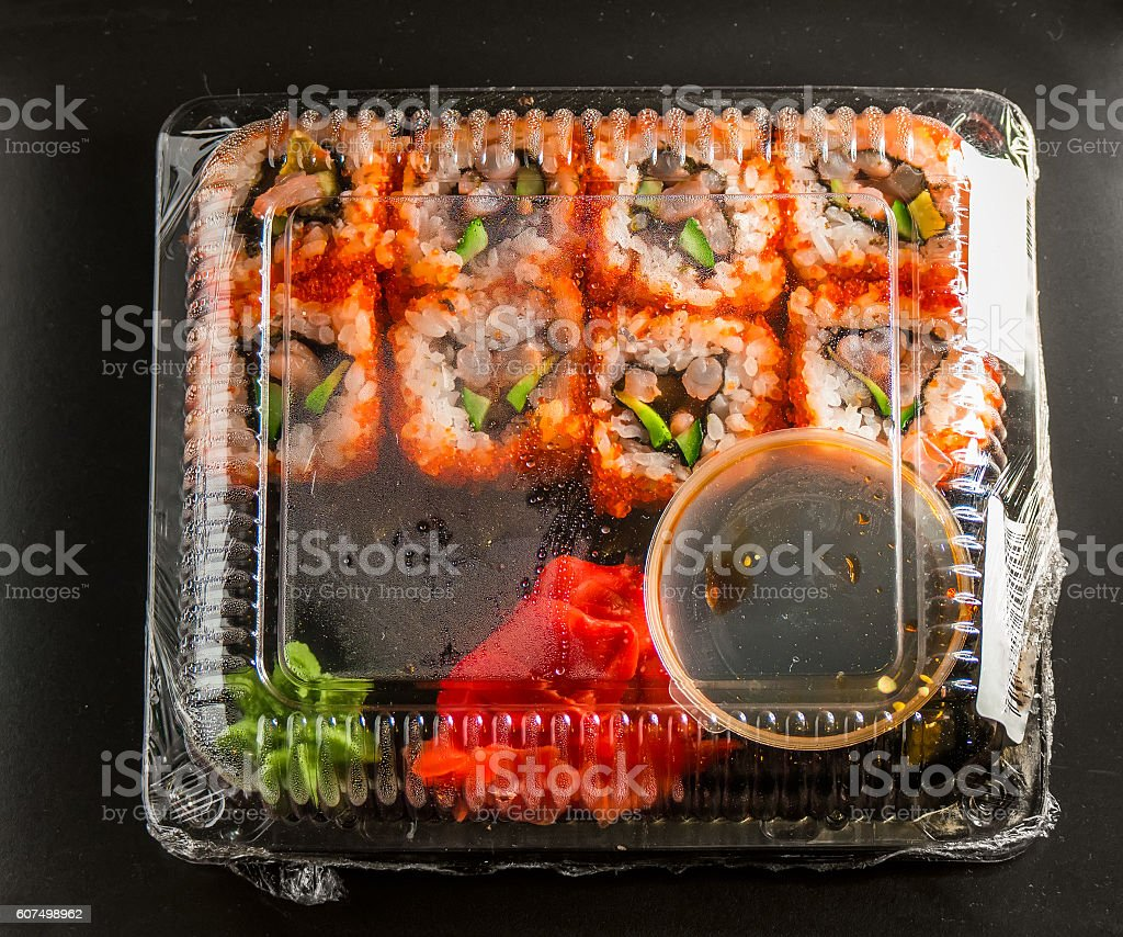Sushi in the package on a black background stock photo