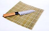 Sushi knife on bamboo cushion