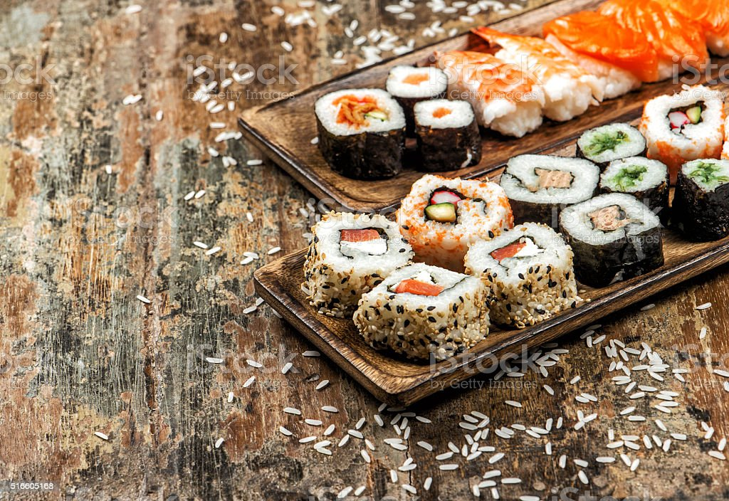 Sushi, maki, sashimi and sushi rolls stock photo