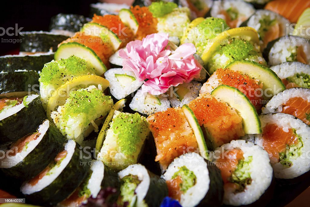 Sushi mix with flowers and banana leafs royalty-free stock photo