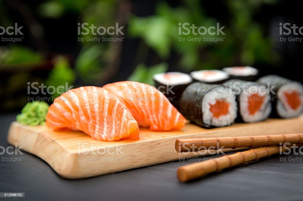 Sushi Nigiri with fresh salmon and Maki roll stock photo