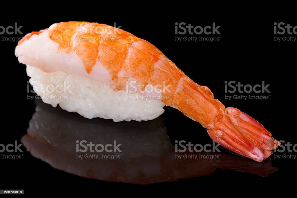 Sushi nigiri with shrimp on black with reflection. Japanese cuisine stock photo