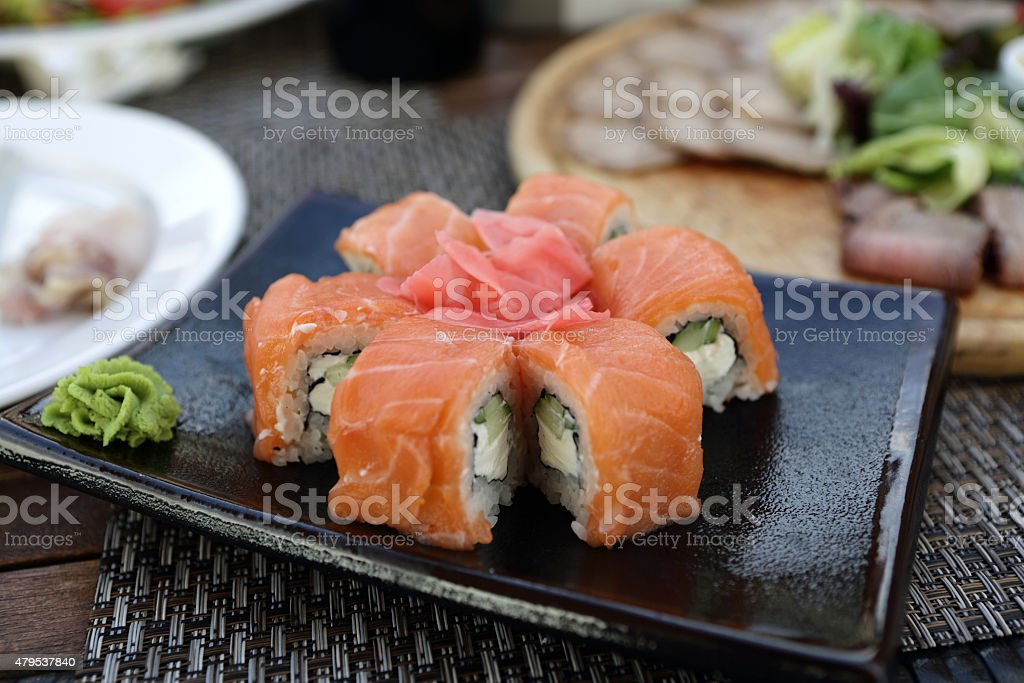 Sushi on a black plate stock photo